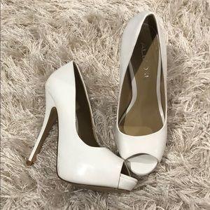 Classic white peep toe pumps